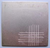 A cross cut of modified UV-curable clear varnish on steel is shown.