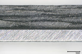 The figure shows a cross section of an aluminum organic sheet composite.
