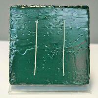 Ein Prüfkörper mit einer hoch-chemikalienbeständige Beschichtungen auf Beton für Biogasreaktoren ist abgebildet.