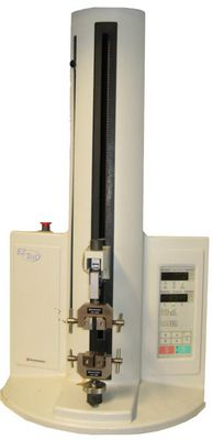 Picture shows the universal testing machine Shimadzu EZ Test with screw grips.