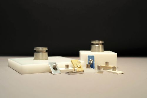 The picture shows adhesive composite test samples of different materials and different shapes.