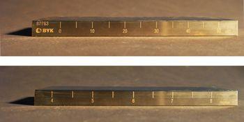 Die Skalen des Grindometers sind dargestellt, wobei einerseits die Zahlen in µm und andererseits in Hegmann-Werten aufgetragen sind.