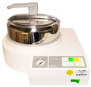 Picture of Palamat practic. Palamat is a polymerization device with compressed air support for heat and cold polymerization.