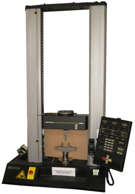 The picture shows the universal testing machine Instron 4469 with three point bending tool.