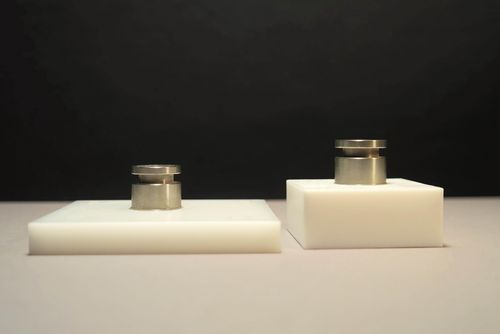 Shown is a combination of adhesively bonded steel cylinders with POM (left) and PTFE (right).