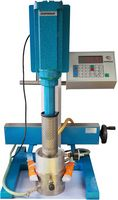 The illustration shows a disperser with container clamping device and temperature-controlled vacuum system in operation.